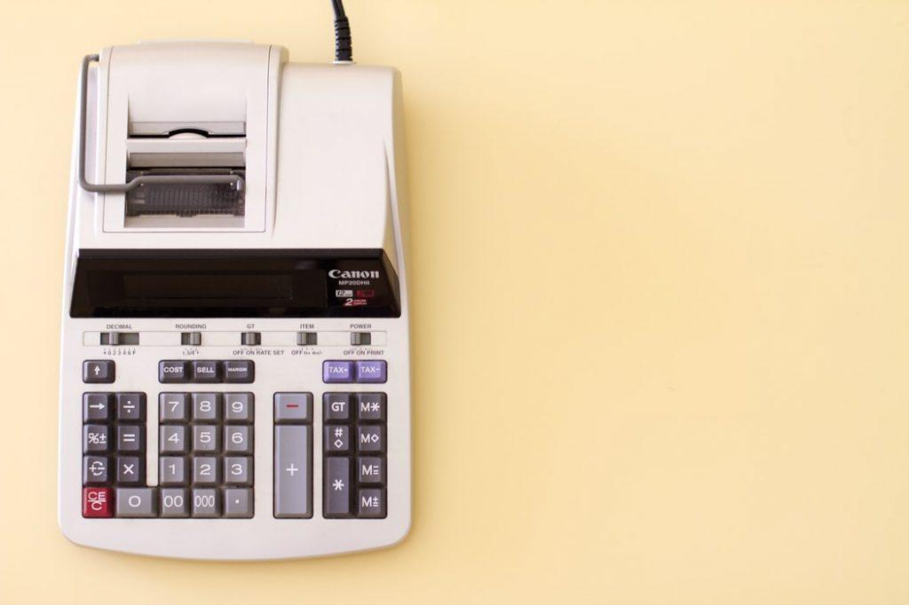 Accounting Calculator against soft orange background by @stellrweb on Unsplash